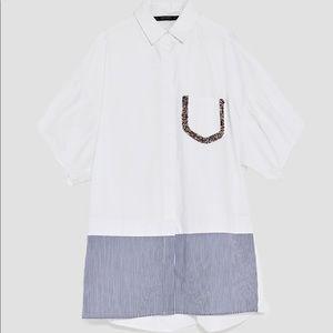 Oversized shirt dress with front pocket appliqués